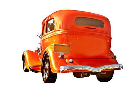 beautifully restored 1930s sedan painted a vibrant orange Фото со стока