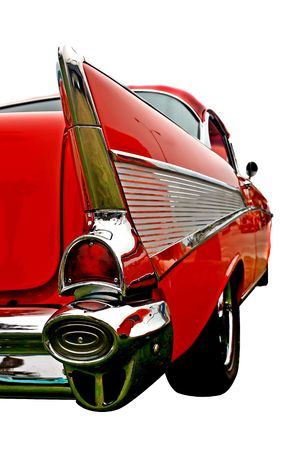 The aft end of a vintage 50s automobile, showing fin styling and swept back lines
