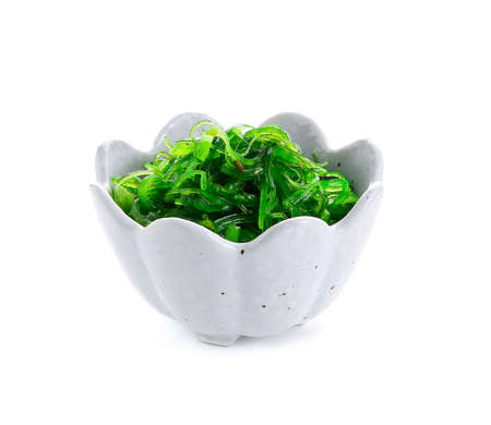 Seaweed salad with sesame seeds isloated on white background