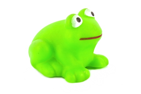 green frog toy on white background photo