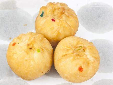 Dessert made of flour stuffed on oil clear sheet photo