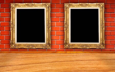 Two golden picture frame on the brick wall with the wooden floor
