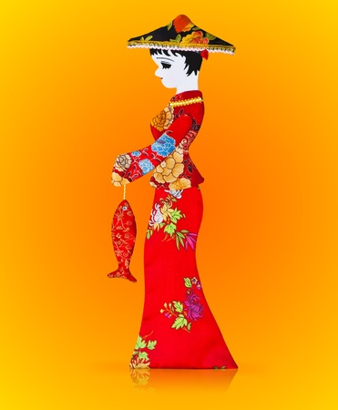 Asian women doll made from a red fabric Stock Photo