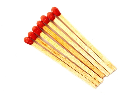 red wooden matches with isolated white background photo