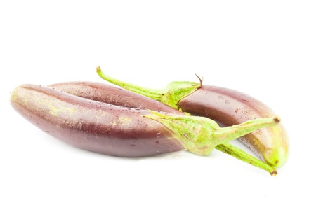 Eggplant purple vegetable closeup with shadow on isolated white background photo