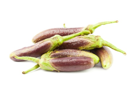 Eggplant purple vegetable closeup on isolated white background photo