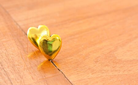 gold hearts on wooden floor photo