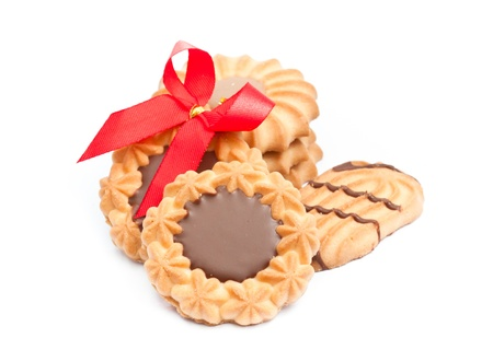 cookies with chocolate  and red ribbon on the white background photo