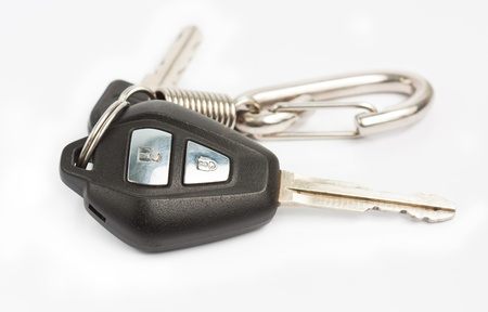 Old car key with remote control on white background photo