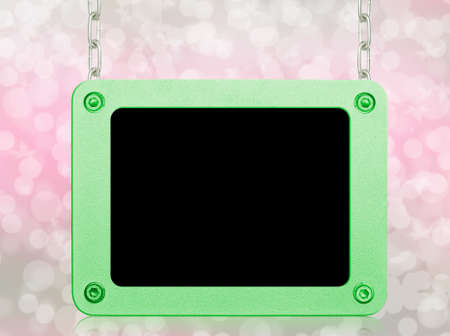 metallic frame picture hanging by chains on isolated white background  Stock Photo