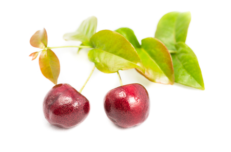Ripe cherry berries with green leaf isolated on white background Stock Photo