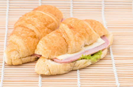 croissant stuffed with ham cheese photo