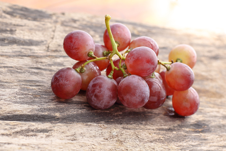 red grapes on a wood Stock Photo