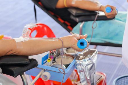 healing process: arm of a donor donating blood at hemotransfusion station