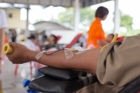 arm of a donor donating blood at hemotransfusion station