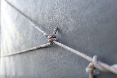 Close up Rope and knot on canvas plasti : ideal use for two choices Stock Photo