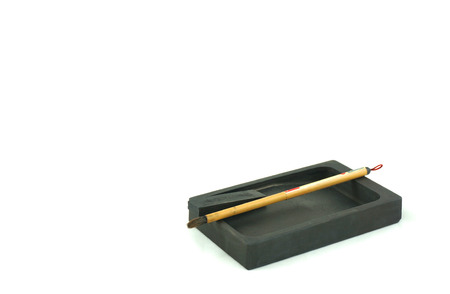 inkstone: The Inkstones and the Chinese paintbrush is a device for writing text and drawing. Chinas culture is invaluable. From the past several thousand years, and successor to the present.                              Stock Photo