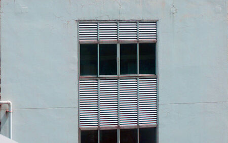 contiguous: Cracks in building walls, cracks is contiguous. Starting from the upper part of the building.
