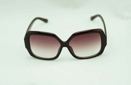 ray ban: Brown sunglasses, edge glasses made of plastic placed on a white background.