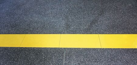 A single yellow line is sign for parking or waiting at that roadside. photo