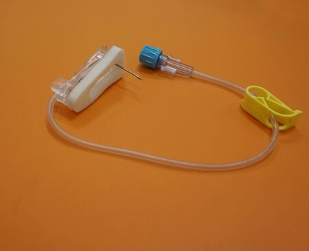 needle tip: Port-A-cath needle, the needle tip is bent, has joint for connected to the tube. Stock Photo