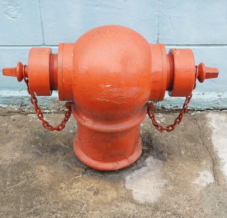 suppression: Red pumps for fire-fighting, the metal is headed for a two-way pipe.