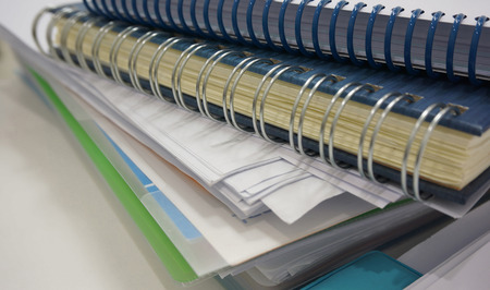office documents: Office documents, the paper notes, account book placed on the desk at work.