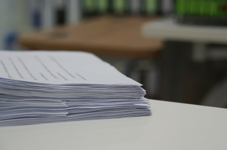 order chaos: Stack of data work sheet was placed on desk in office.