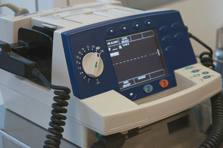 er: Defibrillator unit stand by for emergency case at ER in hospital. Stock Photo
