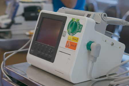 revive: Defibrillator unit stand by for emergency case at ER in hospital. Stock Photo
