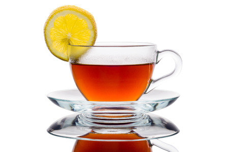 lemon tree: cup of tea and lemon isolated on white