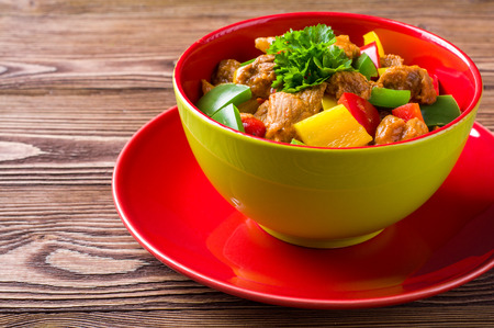 mouthwatering: Delicious goulash on wooden table Stock Photo