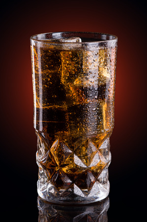 Cold cola in a glass photo