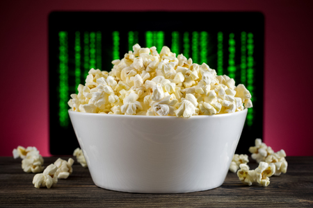 popcorn bowl: Popcorn on the table TV