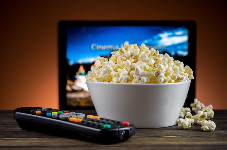 popcorn bowls: Popcorn and a remote control for the TV