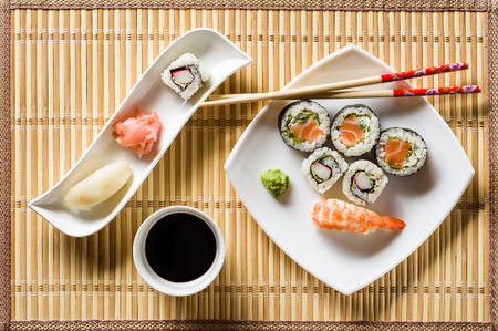 Sushi on white plate top view Banco de Imagens