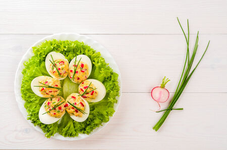 hard boiled: Stuffed eggs on lettuce with chives garnish
