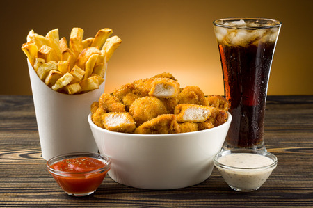 French fries chicken nuggets and cola photo