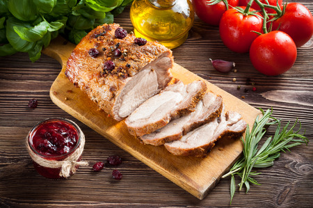 Roasted pork loin with cranberry and rosemary Stock Photo