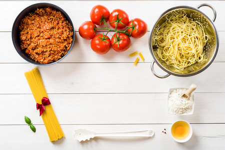 ribbon pasta: Spaghetti and ingredients on the table Stock Photo