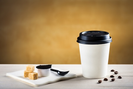 to go cup: Coffee to go on white table