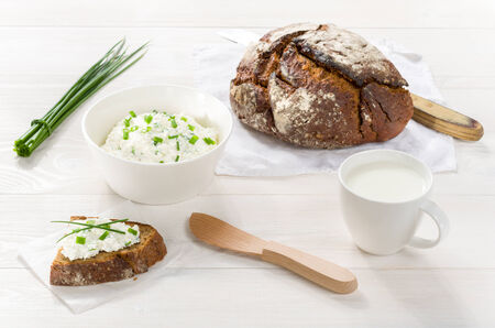Breakfast including cottage cheese, bread and milk photo