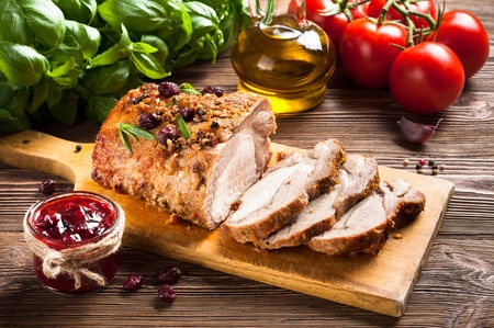 Roasted pork loin with cranberry and rosemary Stockfoto