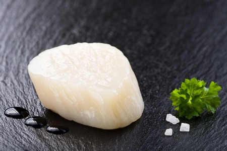 Scallop on black stone plate