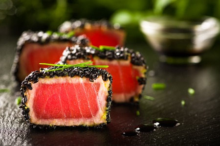 Fried tuna steak in black sesame photo