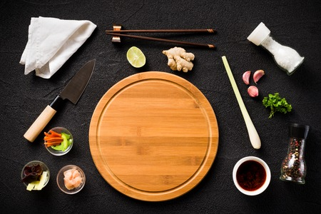 Asian food ingredients and cutting board top view photo