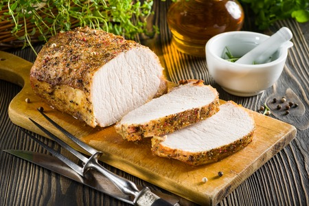 loin: Roasted pork loin on the wooden table