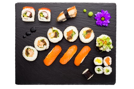 black rice: Sushi on black stone plate isolated top view