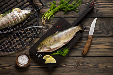 gastronomy: Fresh whole trout fishes prepared to grill top view
