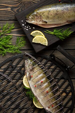 fresh fish: Fresh whole trout fishes prepared to grill top view